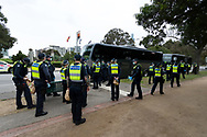 MELBOURNE, VIC - SEPTEMBER 12: Huge numbers of police board busses as they leave the Shrine after successfully preventing the rally during the Melbourne Freedom Walk Rally on September 12, 2020 in Melbourne, Australia. Stage 4 restrictions are in place from 6pm on Sunday 2 August for metropolitan Melbourne. This includes a curfew from 8pm to 5am every evening. During this time people are only allowed to leave their house for work, and essential health, care or safety reasons. Despite this, multiple protests are being arranged to push back against the draconian restrictions in place within metropolitan Melbourne. A Freedom Walk was arranged to take place in the Tan but with hundreds of police and wet weather forecast, only a small number of protesters tried to attend before being ordered to move on. (Photo by Dave Hewison/Speed Media)