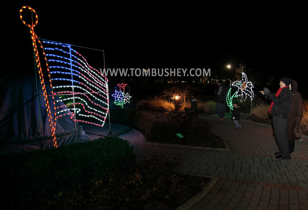 Hamptonburgh, New York - The Holiday Lights in Bloom display at the Orange County Arboretum, in observance of the tenth anniversary of Sept. 11, 2001,  expands into the 9/11 Memorial Garden which is decorated in patriotic colors and feature a large light display of the American flag.