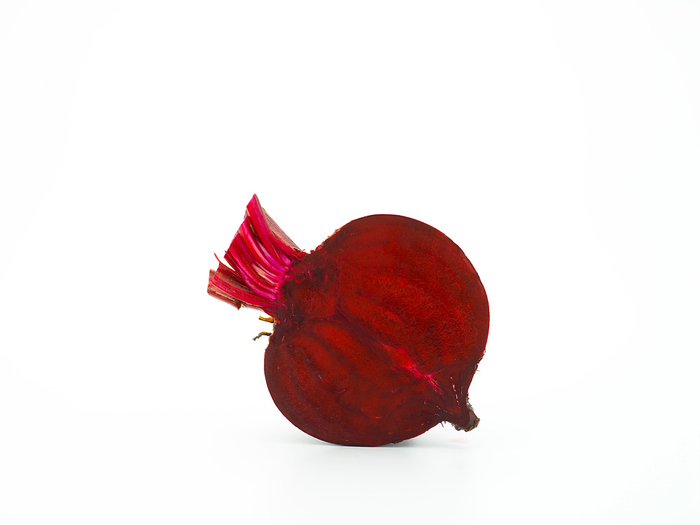 halved beetroot on a white background