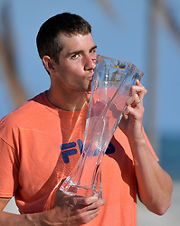 April 1, 2018 - Key Biscayne, Florida, United States Of America - KEY BISCAYNE, FL - APRIL 01: John Isner of the USA poses on Crandon Park Beach with the trophy after beating Alexander Zverev of Germany 6-7 6-4 6-4 in the men's final on Day 14 of the Miami Open Presented by Itau at Crandon Park Tennis Center on April 01, 2018 in Key Biscayne, Florida....People:  John Isner..Transmission Ref:  FLXX..Must call if interested.Michael Storms.Storms Media Group Inc..305-632-3400 - Cell.305-513-5783 - Fax.MikeStorm@aol.com.www.StormsMediaGroup.com (Credit Image: © SMG via ZUMA Wire)