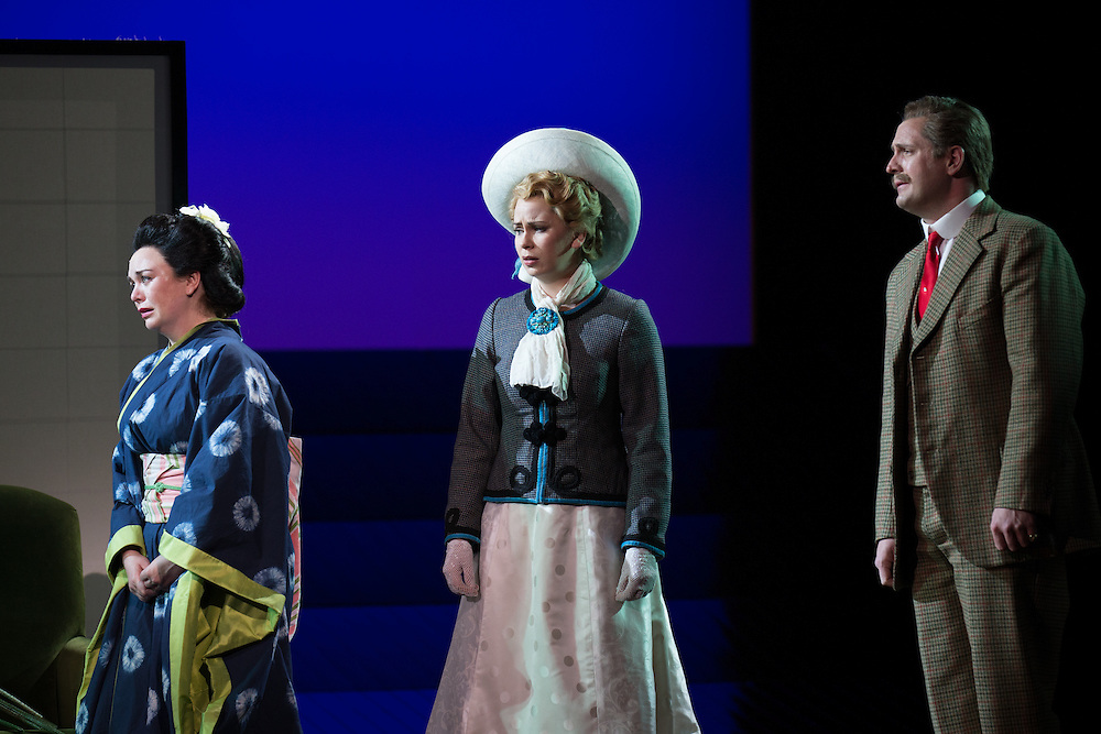 """LONDON, UK, 14 May, 2016. Left to right: Stephanie Windsor-Lewis, Samantha Price and George von Bergen rehearse for the revival of director Anthony Minghella's production of Puccini's opera """"Madam Butterfly"""" at the London Coliseum for the English National Opera. The production opens on 16 May. Photo credit: Scott Rylander."""