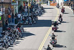 Riding out of Lakeside Avenue in the Weir's during Laconia Motorcycle Week, New Hampshire, USA. Wednesday June 14, 2017. Photography ©2017 Michael Lichter.
