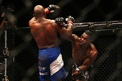 Tumelo Maphutha (Red) attempts to avoid Dalcha Lungiambula (Blue) punch during the Interim Light Heavyweight Title bout of the Extreme Fighting Championships, EFC 52 held at the Grand West Casino in Cape Town, South Africa on the 5th August 2016<br /> <br /> Photo by:   Shaun Roy / Real Time Images