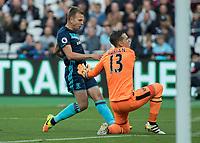 Football - 2016 / 2017 Premier League - West Ham United vs. Middesborough <br /> <br /> Adrian of West Ham winces as he prepares to collide with Jordan Rhodes of Middlesborough at The London Stadium.<br /> <br /> COLORSPORT/DANIEL BEARHAM