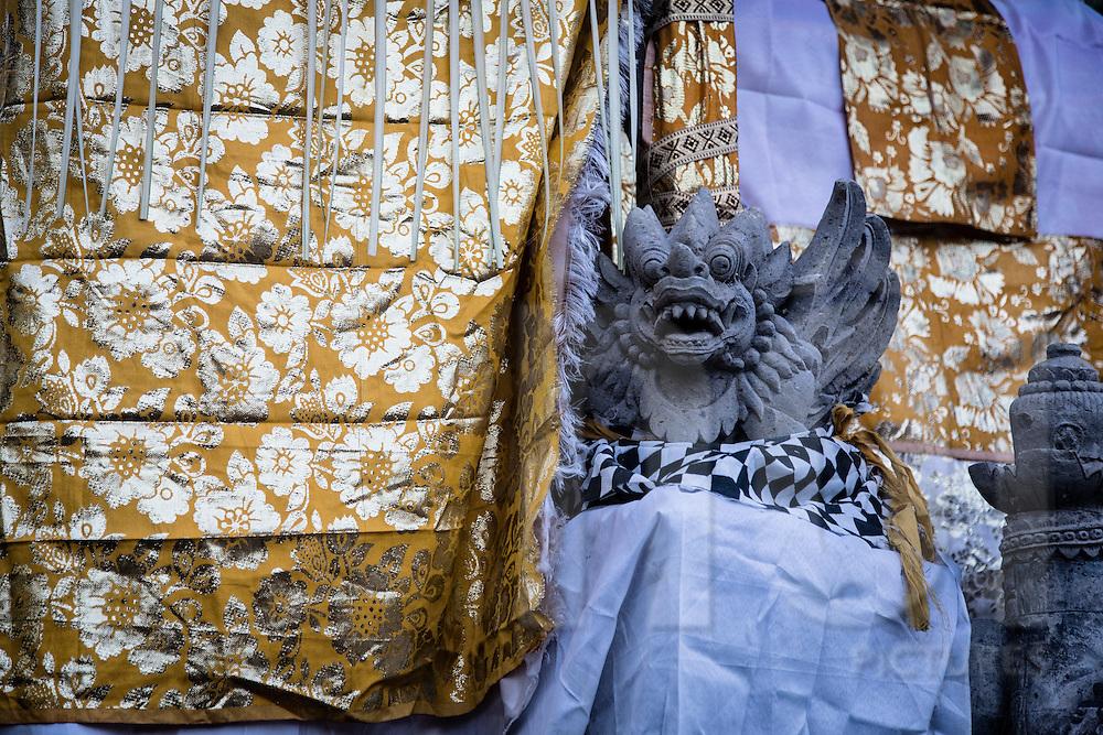 Dragon statue outside a Hindu temple covered in fabric, Ubud area, Bali, Indonesia, Southeast Asia
