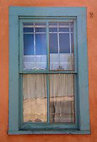 Turquoise window on adobe wall Santa Fe New Mexico
