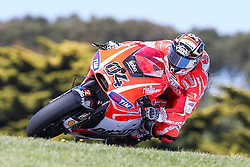 © Licensed to London News Pictures. 19/10/2012. Andrea Dovizioso (ITA) riding for the Ducati Team during the Qualifying day of the round 16 2013 Tissot Australian Moto GP at the  Phillip Island Grand Prix Circuit Victoria, Australia. Photo credit : Asanka Brendon Ratnayake/LNP