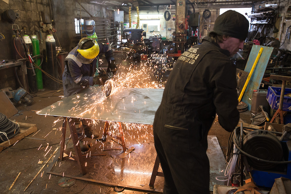 Mallaig Boatyard. Ian MacLeod, fabricator welder (L) cutting steel . Picture Robert Perry 9th April 2016<br /> <br /> Must credit photo to Robert Perry<br /> FEE PAYABLE FOR REPRO USE<br /> FEE PAYABLE FOR ALL INTERNET USE<br /> www.robertperry.co.uk<br /> NB -This image is not to be distributed without the prior consent of the copyright holder.<br /> in using this image you agree to abide by terms and conditions as stated in this caption.<br /> All monies payable to Robert Perry<br /> <br /> (PLEASE DO NOT REMOVE THIS CAPTION)<br /> This image is intended for Editorial use (e.g. news). Any commercial or promotional use requires additional clearance. <br /> Copyright 2014 All rights protected.<br /> first use only<br /> contact details<br /> Robert Perry     <br /> 07702 631 477<br /> robertperryphotos@gmail.com<br /> no internet usage without prior consent.         <br /> Robert Perry reserves the right to pursue unauthorised use of this image . If you violate my intellectual property you may be liable for  damages, loss of income, and profits you derive from the use of this image.