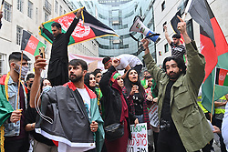 © Licensed to London News Pictures. 28/08/2021. London, UK. Protesters demonstrate outside the BBC Studios taking part in the Global Movement For Peace In Afghanistan demonstration calling for an end to Afghan people suffering. Photo credit: London News Pictures