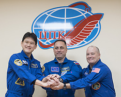 Expedition 54 prime crew members flight engineer Norishige Kanai of Japan Aerospace Exploration Agency (JAXA), right, Soyuz Commander Anton Shkaplerov of Roscosmos, center, and flight engineer Scott Tingle of NASA, right, pose for a picture at the conclusion of a press conference, Saturday, December 16, 2017 at the Cosmonaut Hotel in Baikonur, Kazakhstan. Expedition 54 Soyuz Commander Anton Shkaplerov of Roscosmos, flight engineer Scott Tingle of NASA, and flight engineer Norishige Kanai of Japan Aerospace Exploration Agency (JAXA) are scheduled to launch to the International Space Station aboard the Soyuz spacecraft from the Baikonur Cosmodrome on December 17. Photo by Joel Kowsky / NASA via CNP/ABACAPRESS.COM