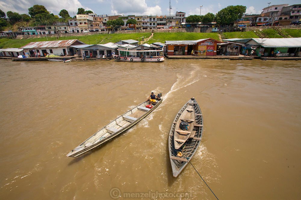 Boats dock at a business center in Mancapuru, Brazil.