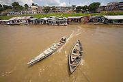 Boats dock at a business center in Mancapuru, Brazil.