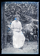 woman sitting in garden outdoors setting France ca 1920s