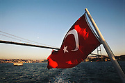 Turkish flag on a ferry boat, on the Bosphorus River, Istanbul, Turkey.