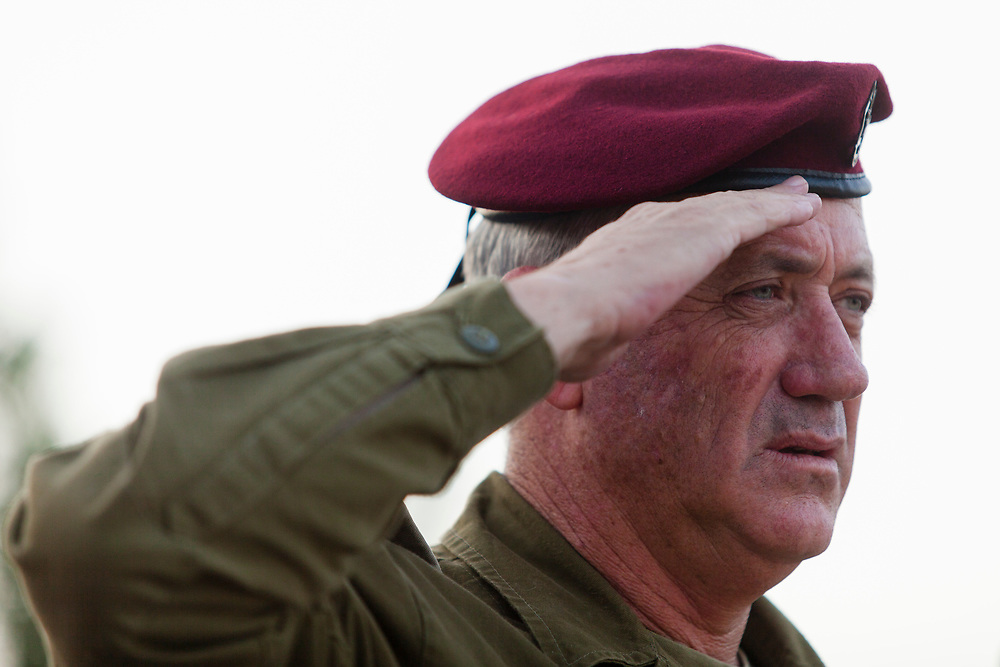 Israeli Chief of Staff, Lieutenant General Benny Gantz salutes during Israel's national anthem at the inauguration ceremony of the Harel Brigade Memorial Site in Jerusalem, on June 2, 2013. The Harel Brigade which had fought in the Jerusalem area during Israel's 1948 War of Independence was a division of the Palmach, an elite fighting force of the Haganah, a Jewish paramilitary organization in what was then the British Mandate of Palestine from 1920 to 1948, which later became the core of the Israel Defense Forces. Today the Harel Birgade is a reserve brigade of the Israel Defense Forces, part of the Northern Command.