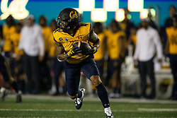California's Nikko Remigio (4) returns a punt from Nevada during the second quarter of an NCAA college football game, Saturday, Sept. 4, 2021, in Berkeley, Calif. (AP Photo/D. Ross Cameron)