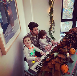 """Nick Jonas releases a photo on Twitter with the following caption: """"""""My beautiful nieces teaching me everything I know on the keys. 🎄😍"""""""". Photo Credit: Twitter *** No USA Distribution *** For Editorial Use Only *** Not to be Published in Books or Photo Books ***  Please note: Fees charged by the agency are for the agency's services only, and do not, nor are they intended to, convey to the user any ownership of Copyright or License in the material. The agency does not claim any ownership including but not limited to Copyright or License in the attached material. By publishing this material you expressly agree to indemnify and to hold the agency and its directors, shareholders and employees harmless from any loss, claims, damages, demands, expenses (including legal fees), or any causes of action or allegation against the agency arising out of or connected in any way with publication of the material."""