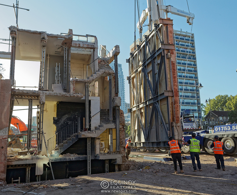London, United Kingdom - 20 September 2019<br /> EXCLUSIVE SET - Aerial construction specialists and demolition experts use a huge crane to carefully lift intact, a twenty five ton, two-story wall, to preserve a famous Banksy rat image which has been covered up for years. Teams from specialist companies have spent over six weeks cutting around the artwork and fitting custom made eight ton steel supports to enable them to save the historic piece of art. Work has started on the construction of a new twenty seven floor art'otel hotel on the site of the old Foundry building in Shoreditch, east London, and a condition of the planning permission was to preserve the historical Banksy graffiti. A second section of the painting, an image of a TV being thrown through a broken window has already been cut out and moved separately. After the hotel construction is complete the two parts of the Banksy painting will be displayed on the hotel. Our pictures show the stages of work to protect the image, culminating in the lifting of the three story wall by crane. Video footage also available.<br /> (photo by: EQUINOXFEATURES.COM)<br /> Picture Data:<br /> Photographer: Equinox Features<br /> Copyright: ©2019 Equinox Licensing Ltd. +443700 780000<br /> Contact: Equinox Features<br /> Date Taken: 20190920<br /> Time Taken: 17113231<br /> www.newspics.com