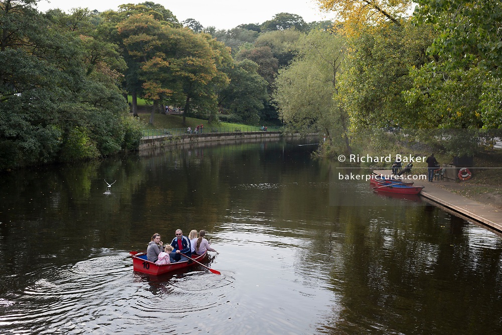 A family of four enjoy a Sunday afternoon boating in a small rowing boat while on the river Wansbeck, on 24th September, 2017, in Morpeth, England.