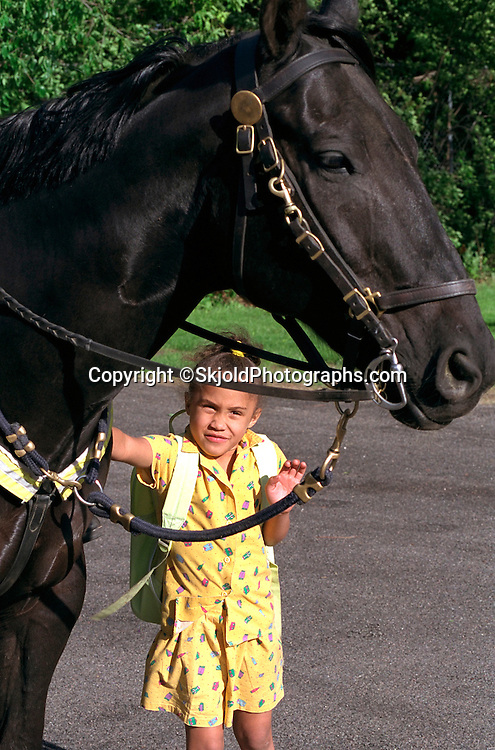 Girl age 6 petting horse at Taste of Frogtown Festival.  St Paul  Minnesota USA