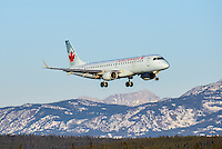 Air Canada Embraer 190 regional jet landing on a sunny Yukon afternoon