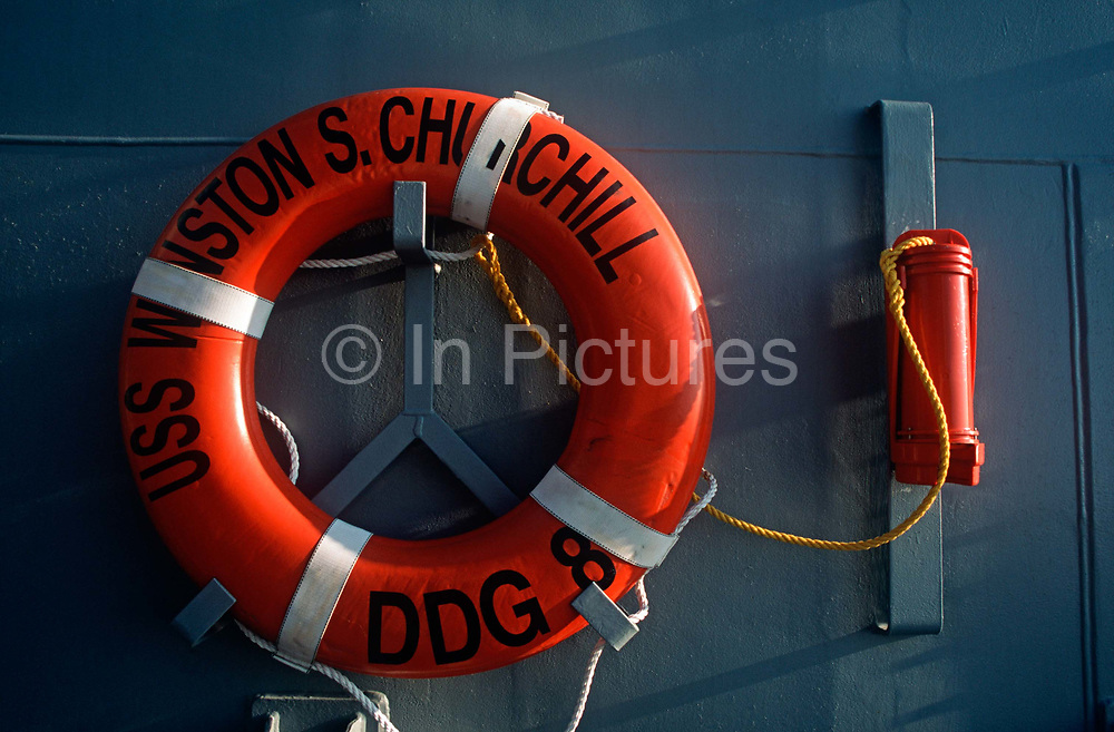 A detail of a ships lifebuoy on board the US Navys USS Winston Churchill during its visit to the UK, on 23rd August 2001, in Portsmouth, England. The USS Winston Churchill designated DDG-81, is one of the Navys stealth warships that was on exercise in British waters in 2001. The Churchill is an Arleigh Burke-class guided missile destroyer of the United States Navy. She is the 31st destroyer of a planned 62-ship class. The Churchill is named after the British Prime Minister Sir Winston Churchill and her home port is NS Norfolk, Virginia.