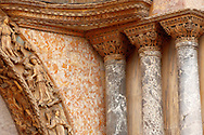 Detailed carving and marble column on the facade of Saint Marks Basilica Venice