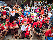 09 NOVEMBER 2015 - YANGON, MYANMAR:  People wait for Aung San Suu Kyi at NLD headquarters Monday evenng. Thousands of National League for Democracy (NLD) supporters gathered at NLD headquarters on Shwegondaing Road in central Yangon to celebrate their apparent landslide victory in Myanmar's national elections that took place Sunday. The announcement of official results was delayed repeatedly Monday, but early reports are that the NLD did very well against the incumbent USDP.    PHOTO BY JACK KURTZ