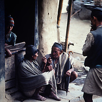 Villagers converse outside a teahouse in the Marsyandi Valley east of Annapurna in Nepal.