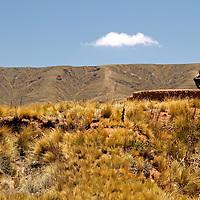 South America, Bolivia, Tiwanaku. Bolivian landscape and man near Tiwanaku.