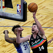 ORLANDO, FL - APRIL 12: Drew Eubanks #14 of the San Antonio Spurs attempts a shot over Wendell Carter Jr. #34 of the Orlando Magic during the first half at Amway Center on April 12, 2021 in Orlando, Florida. NOTE TO USER: User expressly acknowledges and agrees that, by downloading and or using this photograph, User is consenting to the terms and conditions of the Getty Images License Agreement. (Photo by Alex Menendez/Getty Images)*** Local Caption *** Drew Eubanks; Wendell Carter Jr.