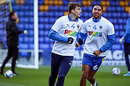 AFC Wimbledon defender Steve Seddon (42) and AFC Wimbledon defender Terell Thomas (6) warming up prior to kick off during the EFL Sky Bet League 1 match between AFC Wimbledon and Bristol Rovers at Plough Lane, London, United Kingdom on 5 December 2020.
