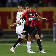 Genclerbirligi's (R) Jimmy Durmaz and Galatasaray's (L) Felipe Melo during their Turkish Superleague soccer match Genclerbirligi between Galatasaray at the 19 Mayis stadium in Ankara Turkey on Friday 19 October 2012. Photo by TURKPIX