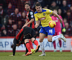 Huddersfield Town's Conor Coady wins the ball from Bournemouth's Matt Ritchie - Photo mandatory by-line: Paul Knight/JMP - Mobile: 07966 386802 - 14/02/2015 - SPORT - Football - Bournemouth - Goldsands Stadium - AFC Bournemouth v Huddersfield Town - Sky Bet Championship