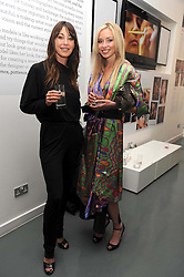 Left to right, TAMARA MELLON and NOELLE RENO at a party to celebrate the launch of the Bobbi Brown Makeup Manual held at the Getty Images Gallery, 46 Eastcastle Street, London W1 on 29th January 2009.