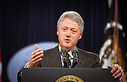 President Clinton answers a question during a press conference at the White House June 25, 1999. Clinton called on Congress to work with him in passing legislation where the two political parties have common ground now that the conflict in Kosovo has been resolved.
