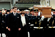 Francois Mitterrand Funeral in his home town of Jarnac in the Charente in south western France 11 January 1996<br />The Danielle Mitterrand, wearing white scarf and no hat, the wife of Francois Mitterrand follow his coffin at the former Presidents funeral. Second from left at the rear is the former Presidents Mistress Anne Pingeot wearing black hat.
