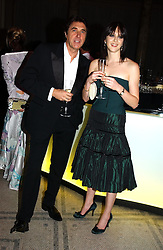 Singer BRYAN FERRY and KATIE TURNER  at the 2004 British Fashion Awards held at Thhe V&A museum, London on 2nd November 2004.<br /><br />NON EXCLUSIVE - WORLD RIGHTS