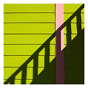 Abstract picture of green and pink painted weatherboards on building, near Death Valley National Park, California