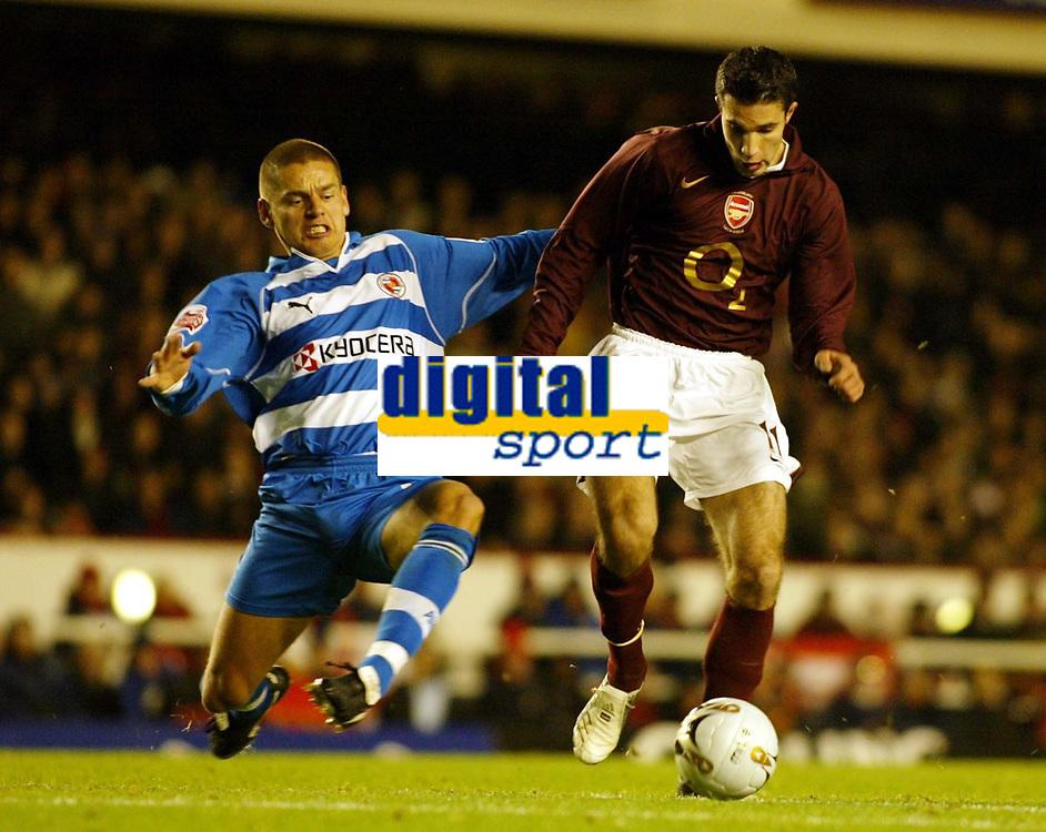 Photo: Chris Ratcliffe.<br />Arsenal v Reading. Carling Cup. 29/11/2005.<br />Ivar Ingimarsson challenges Robin Van Persie