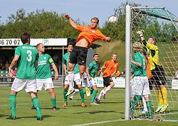 Jeppe Christiansen (FC Helsingør) i luften under kampen i 2. Division Øst mellem Boldklubben Avarta og FC Helsingør den 19. august 2012 i Espelunden. (Foto: Claus Birch).
