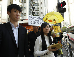 April 28, 2017 - Hong Kong, CHINA - Disqualified Hong Kong pro-independence lawmakers, Baggio Leung ( L ) and Yau Wai-ching ( R ) are seen on the street after appeared on court today charged with unlawful assembly and attempted forced entry. 2017, Apr-28 Hong Kong. ZUMA/Liau Chung Ren (Credit Image: © Liau Chung Ren via ZUMA Wire)