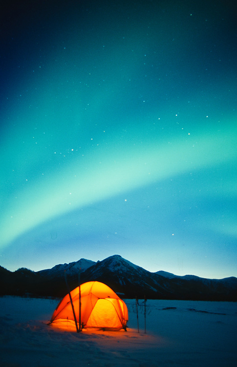 Alaska. Gates of the Arctic NP. Brooks Range. The Northern Lights (Aurora Borealis) dance over the camp of a backcountry skier.