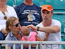 March 24, 2019 - Miami, FL, USA - Parents try to quiet their crying baby as Venus Williams prepares to serve Daria Kasatkina on Sunday, March, 24, 2019 at the Miami Open in Miami Gardens, Fla. (Credit Image: © Charles Trainor Jr/Miami Herald/TNS via ZUMA Wire)