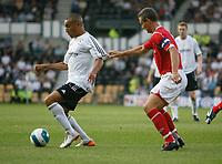 Photo: Steve Bond.<br />Derby County v Nottingham Forest. Pre Season Friendly. 31/07/2007.  Craig fagan (L) shields the ball from Ian Breckin (R)