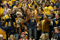 Jan 6, 2018; Morgantown, WV, USA; West Virginia Mountaineers students celebrate during the first half against the Oklahoma Sooners at WVU Coliseum. Mandatory Credit: Ben Queen-USA TODAY Sports