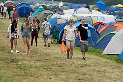 © Licensed to London News Pictures. 05/09/2014. Isle of Wight, UK. Festival goers in the campsite of Bestival 2014 Day 2 Friday.  This weekend's headliners include Chic featuring Nile Rodgers, Foals and Outcast Photo credit : Richard Isaac/LNP