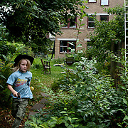 Linköping, Sweden, August 19, 2012.<br /> A boy plays in the garden of Stolplyckan co-housing, the second biggest collective in Sweden with its 184 apartments.