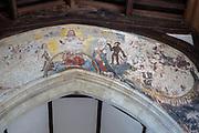 Village parish church of All Saints, Chelsworth, Suffolk, England, UK remains of doom painting on chancel arch
