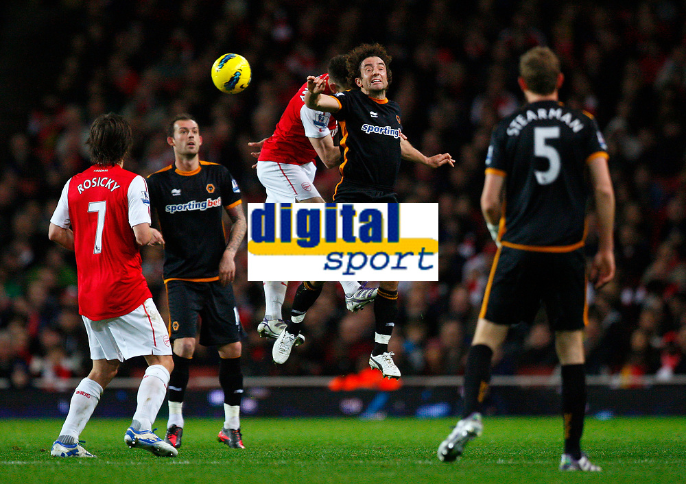 20111227: LONDON, UK - Barclays Premier League 2011/2012: Arsenal vS Wolverhampton Wanderers.<br /> In photo: Stephen Hunt of Wolverhampton Wanderers and Laurent Koscielny of Arsenal leap for the ball.<br /> PHOTO: CITYFILES